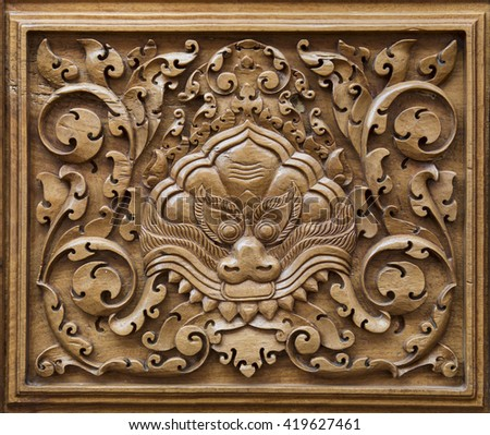 Vintage wood carved ornament in a ancient building in Cambodia - stock photo