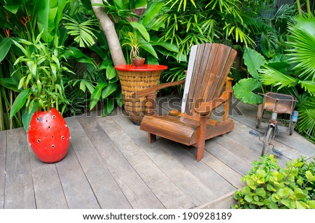 Vintage wood chair in beautiful garden - stock photo