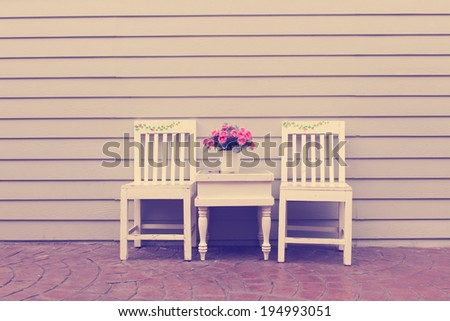 Vintage wood chairs with flower decoration outdoor
