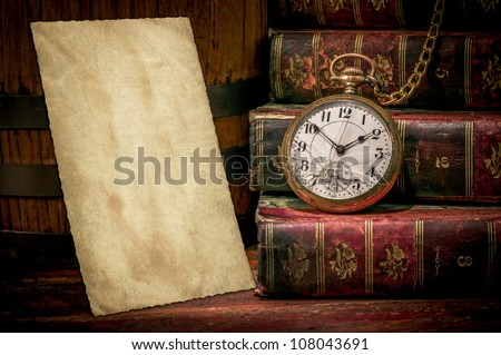 Vintage wood desk with old photo paper texture, books and old pocket clock in low-key. Concept of time,the past or deadline. - stock photo