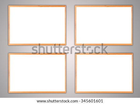 Vintage wood four blank frame on white wall. - stock photo