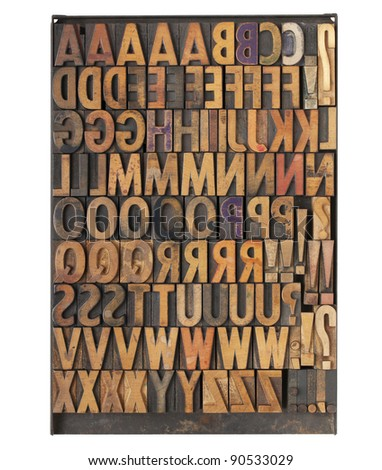 vintage wood letterpress printing blocks on a metal tray - the entire English alphabet with duplicate symbols and punctuation - stock photo