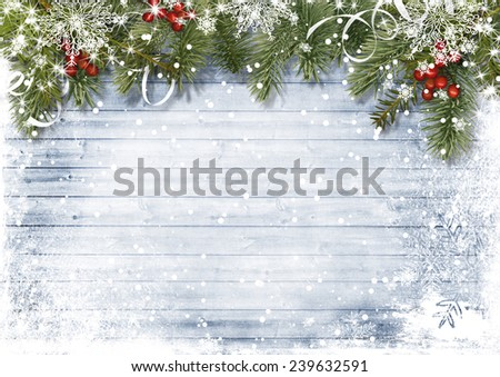 Vintage wood texture with snow, holly and firtree - stock photo