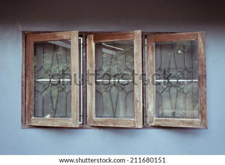 vintage wood window on grey background - stock photo