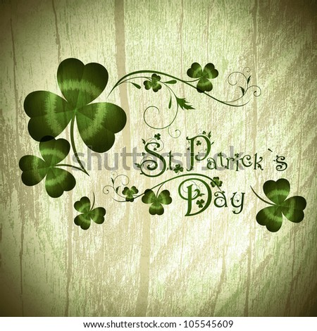 Vintage wooden background with St.Patrick day greeting with shamrocks - stock photo