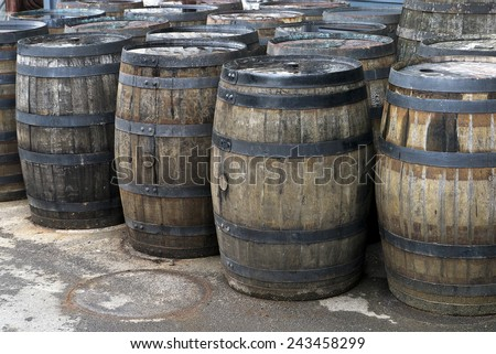 Vintage wooden barrels; old wooden barrels standing on wharf  - stock photo