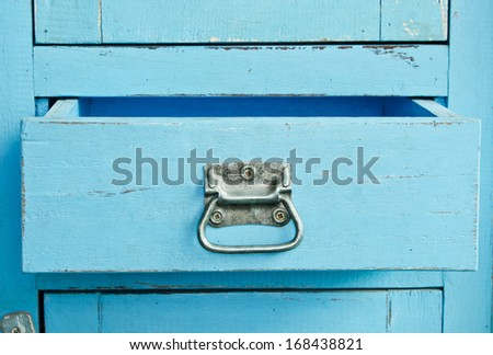 Vintage wooden blue cabinet with open drawer - stock photo