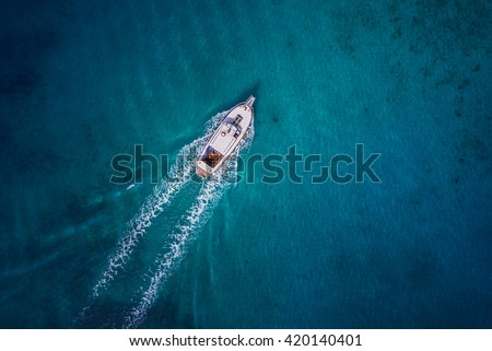 Vintage wooden boat in coral sea. Boat drone photo. - stock photo