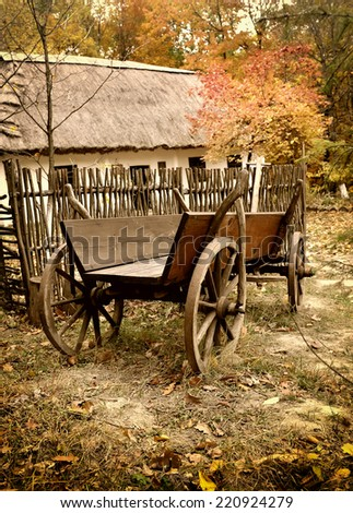 Vintage wooden cart in the yard in the autumn. Ukrainian Museum of Life and Architecture. - stock photo