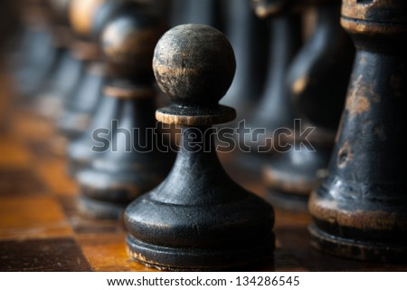 Vintage wooden chess pieces - stock photo