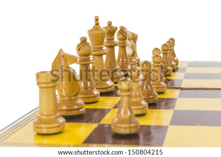 Vintage wooden chess set white side line up. - stock photo
