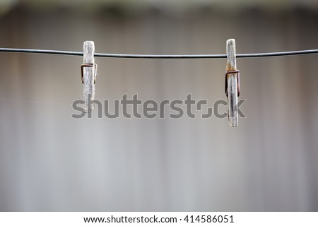 vintage wooden clothespins on wooden fence background - stock photo