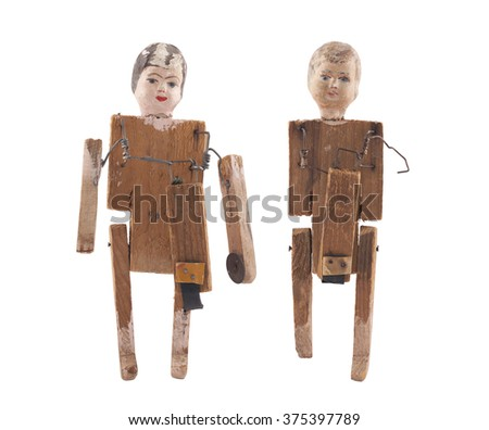 Vintage wooden dolls isolated on white background with clipping path - stock photo