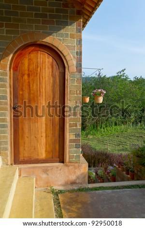 vintage wooden door and garden - stock photo