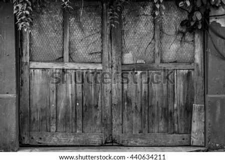 Vintage wooden door - black and white .