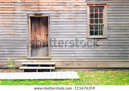 Vintage wooden door, wall and window - stock photo