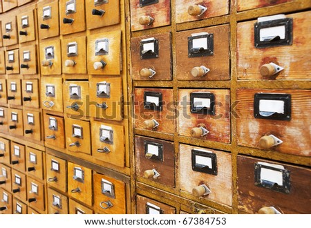 Vintage wooden drawer with white empty tags - stock photo
