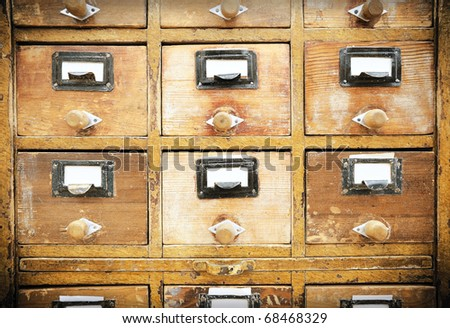 Vintage wooden drawers with empty tags