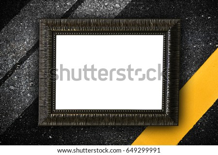 Vintage wooden frame on asphalt with empty space inside
