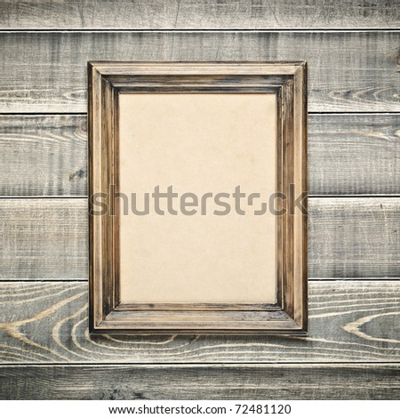 Vintage wooden frame with an empty cardboard - stock photo
