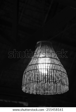 Vintage wooden hanging ceiling lamp in the room - stock photo