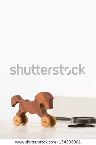 Vintage Wooden Horse on Santa's work table  - stock photo
