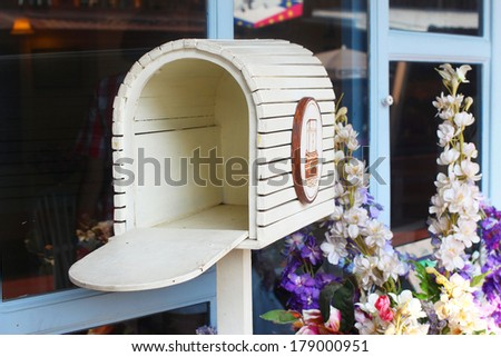 Vintage Wooden Mailbox In Garden - stock photo