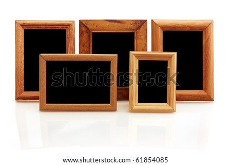 vintage wooden photo frames on white background with reflection - stock photo
