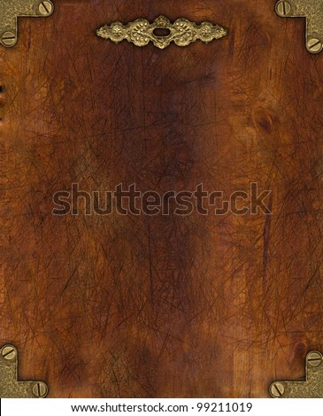 Vintage wooden plate with brass corners and decoration - stock photo