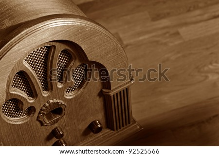 Vintage wooden radio on wood background with copy space.  Macro with shallow dof. - stock photo
