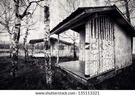 vintage wooden spooky cabin in the woods - stock photo