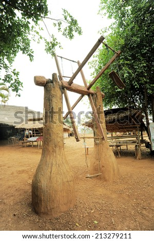 vintage wooden swing in country side - stock photo