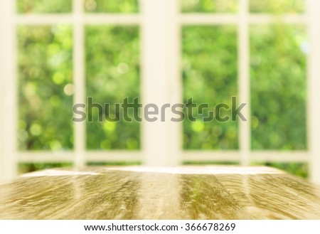 Vintage wooden table by white window background