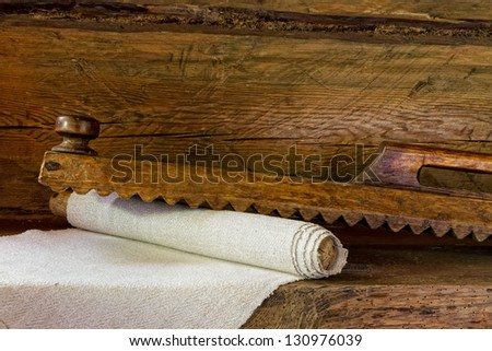 vintage wooden tools for wash ironing, retro iron - stock photo