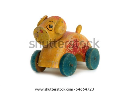 Vintage wooden toy dog with wheels - stock photo