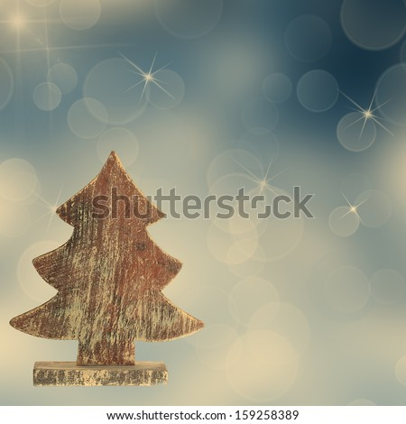 Vintage wooden tree on a colored background - stock photo
