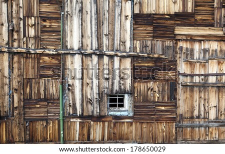 Vintage wooden wall with window - stock photo