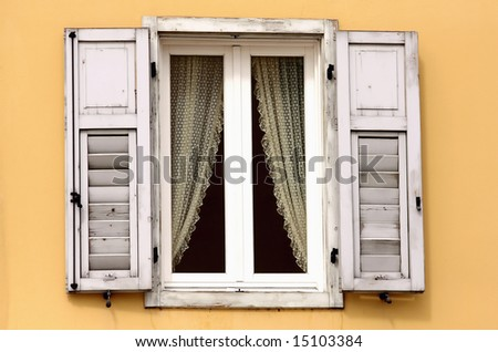 Vintage wooden window with lace curtain - stock photo