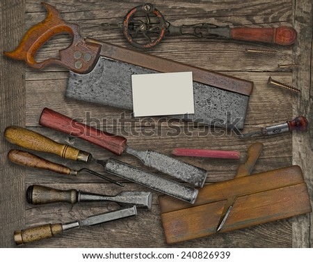 vintage woodworking  tools over wooden bench, blank business card for your text - stock photo