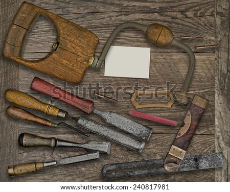 vintage woodworking  tools over wooden bench, blank plate and business card for your text - stock photo