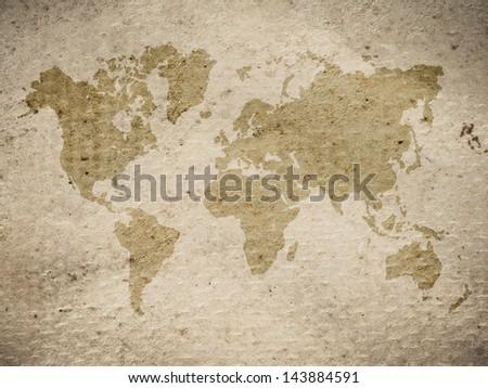 vintage world map on grungy background - stock photo