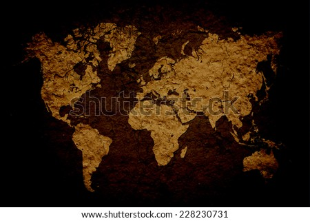 vintage world map with wall background - stock photo