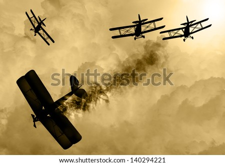 Vintage world war one biplanes and engaged in a dog fight  in a cloudy sky. One had success in shooting down the enemy plane. Original Illustration image. - stock photo