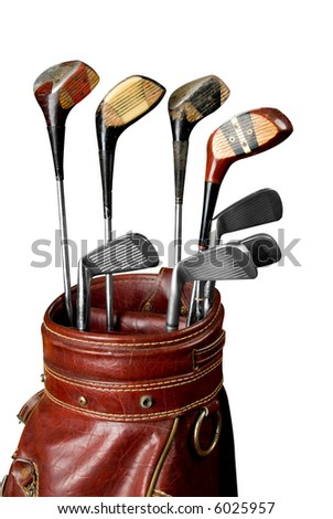 Vintage worn Golf clubs in an old bag isolated over a white background with a clipping path - stock photo