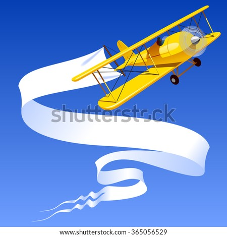 Vintage yellow airplane with blank banner in the blue sky. Contain the Clipping Path - stock photo