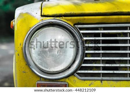 Vintage yellow car headlight - stock photo