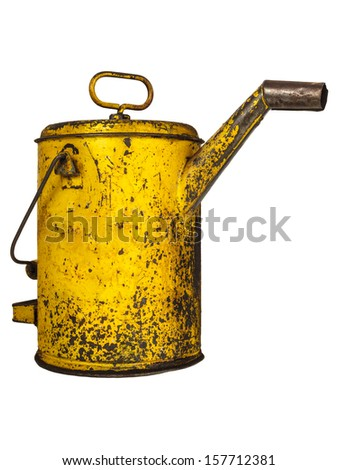 Vintage yellow lubricant oil can isolated on a white background - stock photo