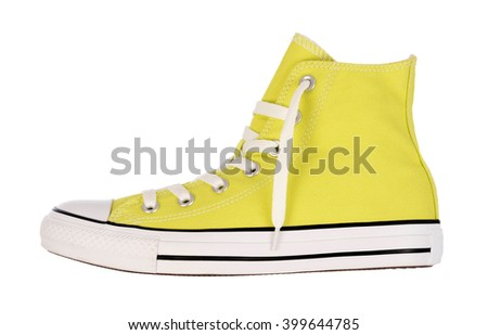 Vintage yellow sneaker on white background