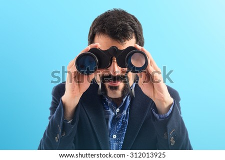 Vintage young man with binoculars  - stock photo