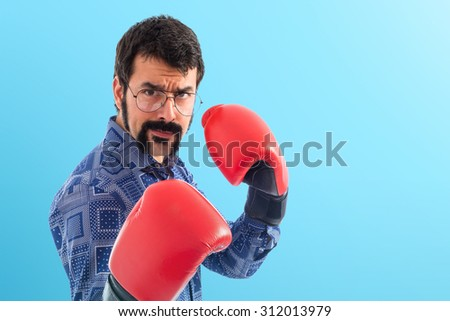 Vintage young man with boxing gloves  - stock photo